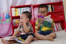 Photo of toddlers reading